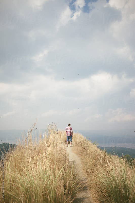 Man Enjoying Nature and View at Top of Hill of Taal Volcano Crater by Joselito Briones for Stocksy United
