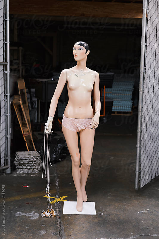 old weird mannequin standing in a warehouse. by Lucas Saugen for Stocksy United