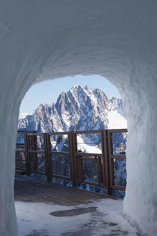 Mont Blanc massif through a tunnel in the snow by Luca Pierro for Stocksy United