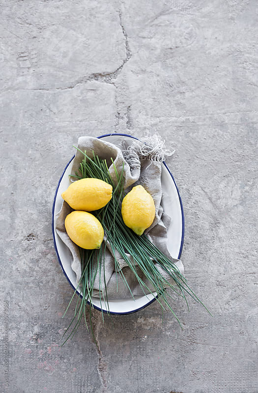 A decorated plate with lemons and chives  by Lydia Cazorla for Stocksy United