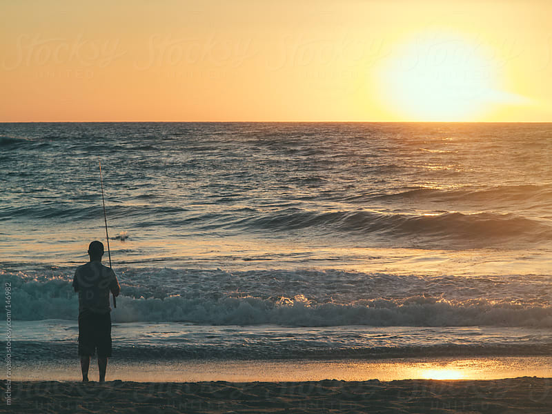 Fisherman at sunset by michela ravasio for Stocksy United