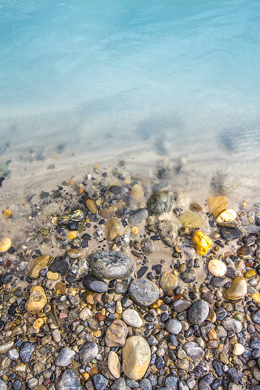 pebbles on the shore by ALAN SHAPIRO for Stocksy United