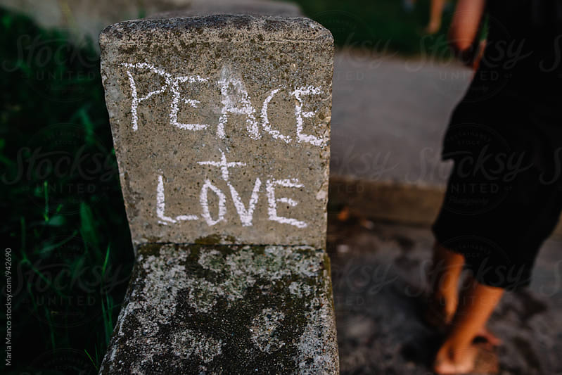 peace and love chalk grafitti by Maria Manco for Stocksy United