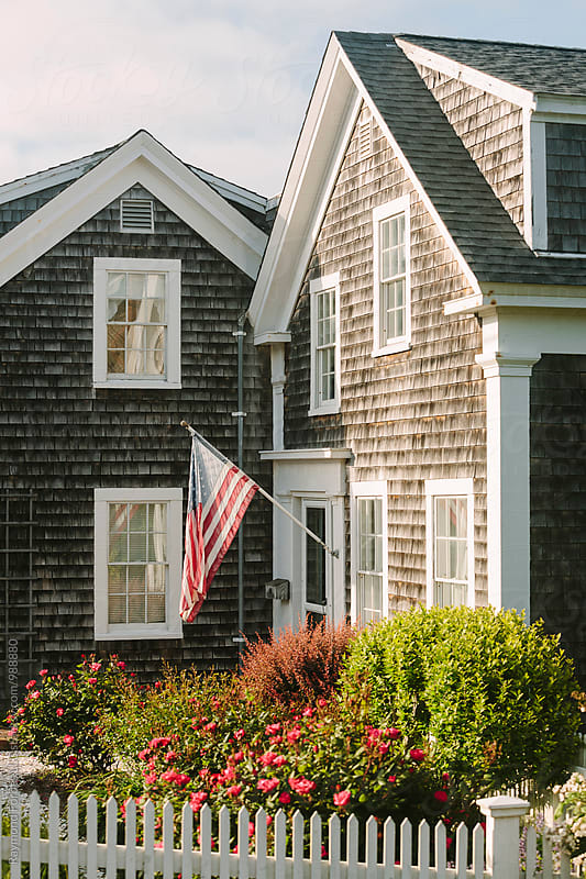 Cape Cod House with American Flag