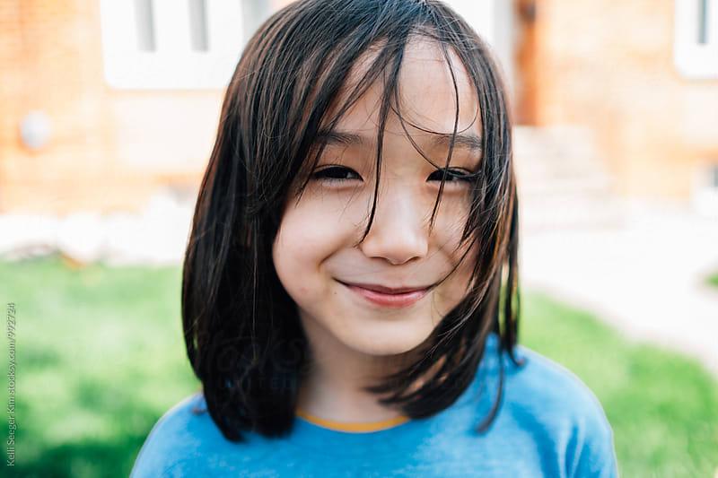 Portrait of cute mixed race boy by kelli kim for Stocksy United