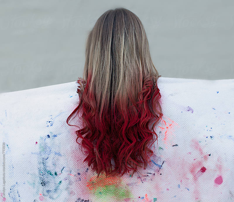 Long blonde hair with red color sprayed on the ends - dip dye by Carolyn Lagattuta for Stocksy United