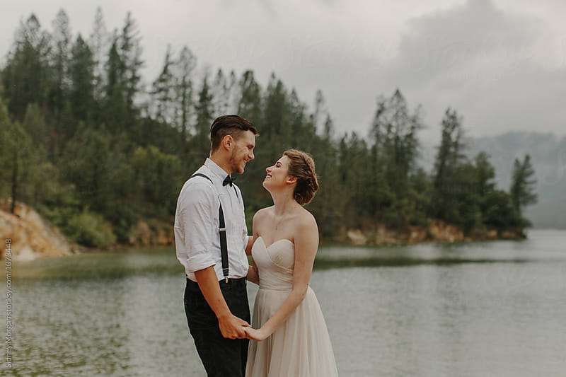 Couple in front of Lake by Sidney Morgan for Stocksy United
