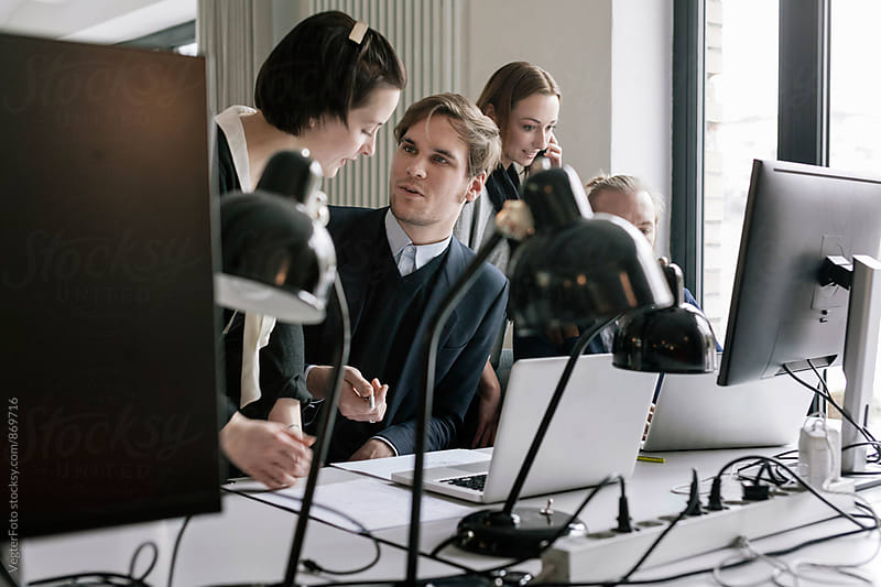 Young business people working together by VegterFoto for Stocksy United