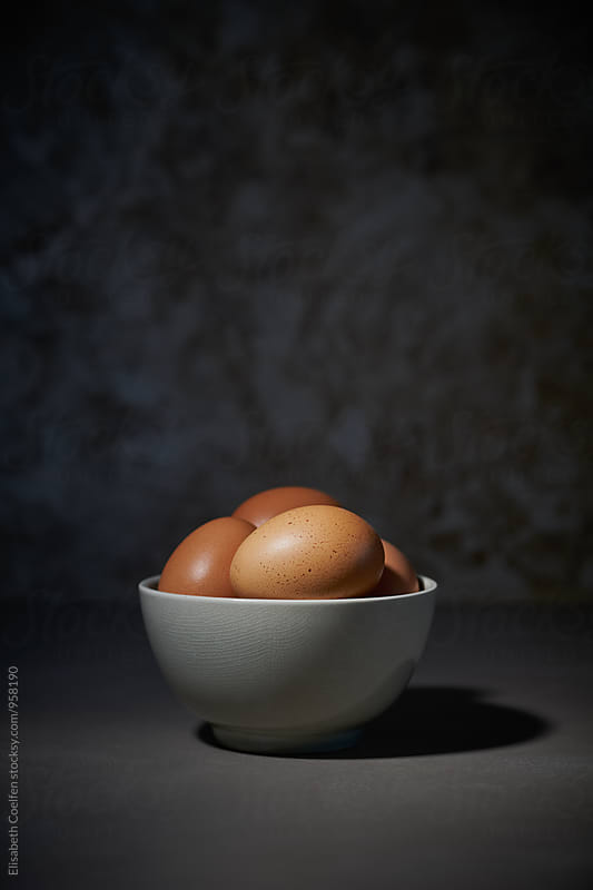 Fresh brown chicken eggs in a bowl by Elisabeth Coelfen for Stocksy United