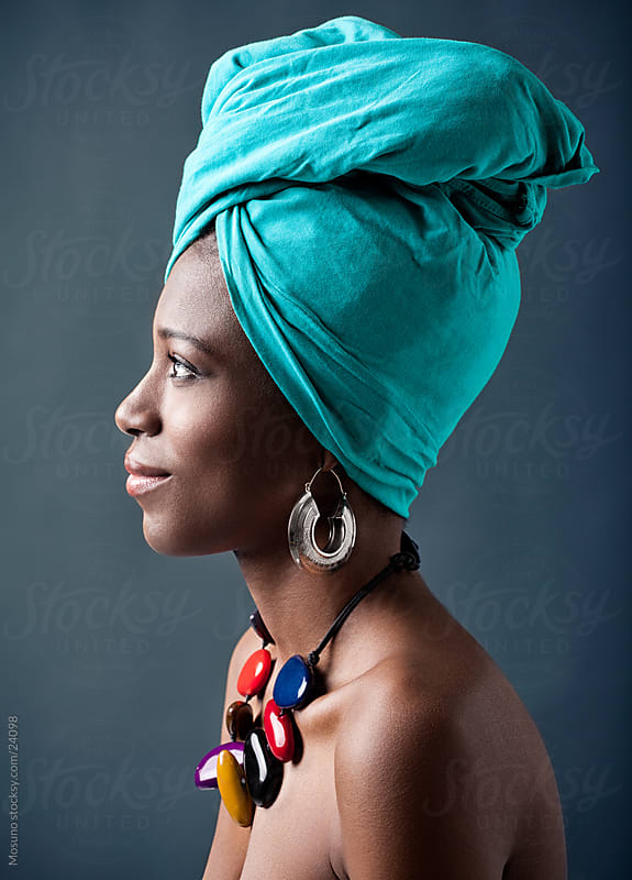 Beautiful african woman with a turban on her head. by Mosuno for Stocksy United