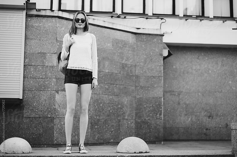 Young woman posing at the street by Lyuba Burakova for Stocksy United