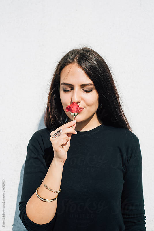 Portrait of beautiful woman with red rose by Kate & Mary for Stocksy United