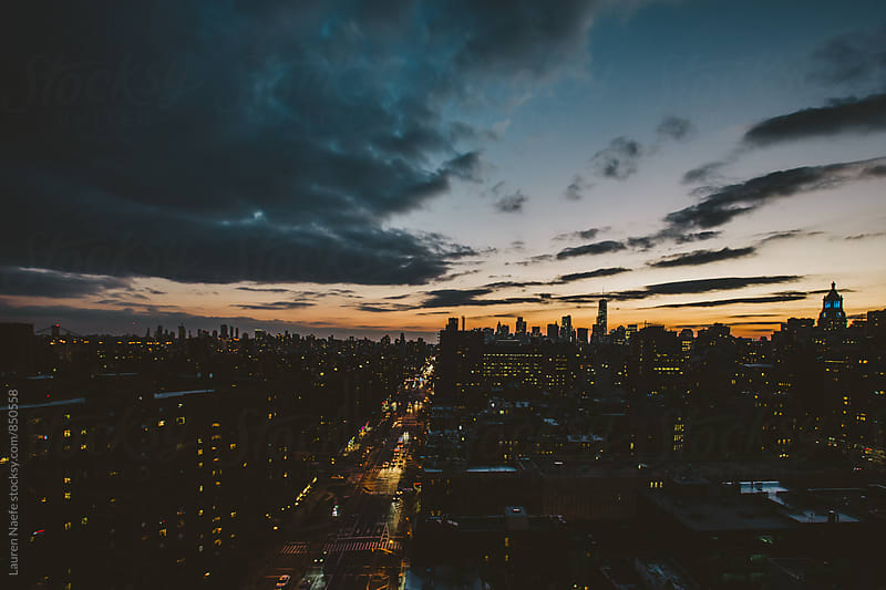 New York City skyline at night by Lauren Naefe for Stocksy United