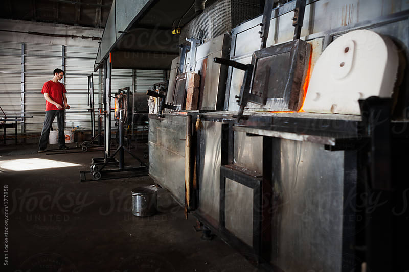 Glass: Focus on Artist at End of Bank of Furnaces by Sean Locke for Stocksy United