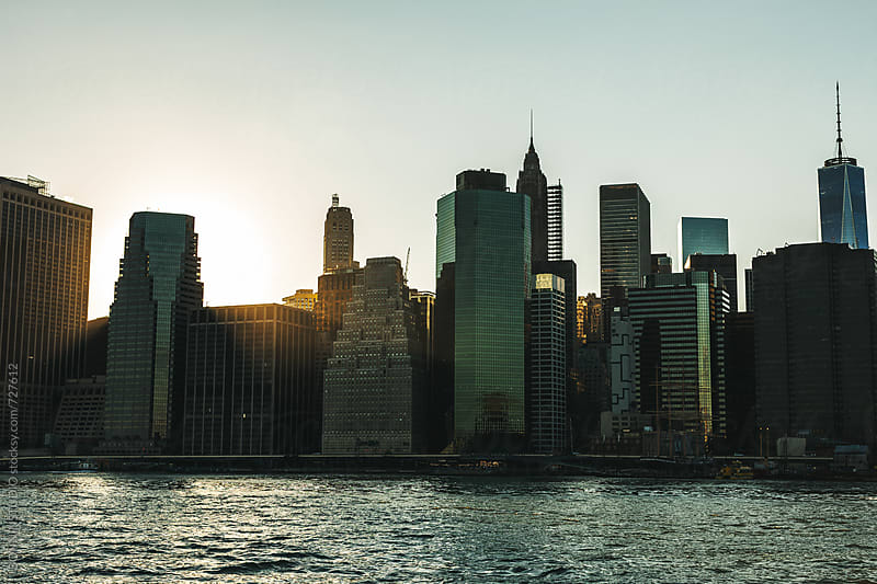 Manhattan financial district at sunset. by BONNINSTUDIO for Stocksy United
