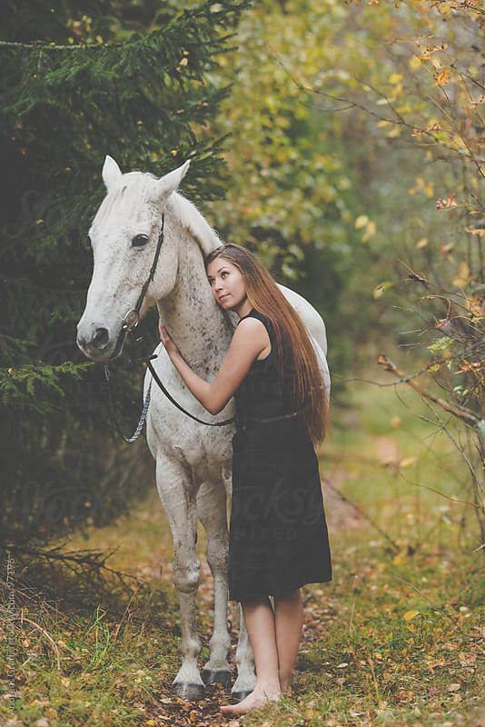 girl with a white horse by Andreas Gradin for Stocksy United