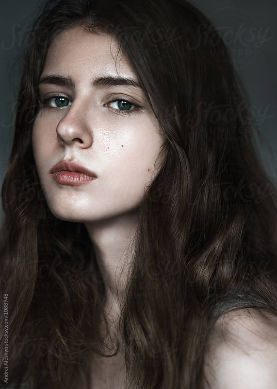 portrait of a beautiful brunette close-up by Andrei Aleshyn for Stocksy United