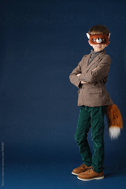 Boy looking confident in his fox costume by Rebecca Spencer for Stocksy United