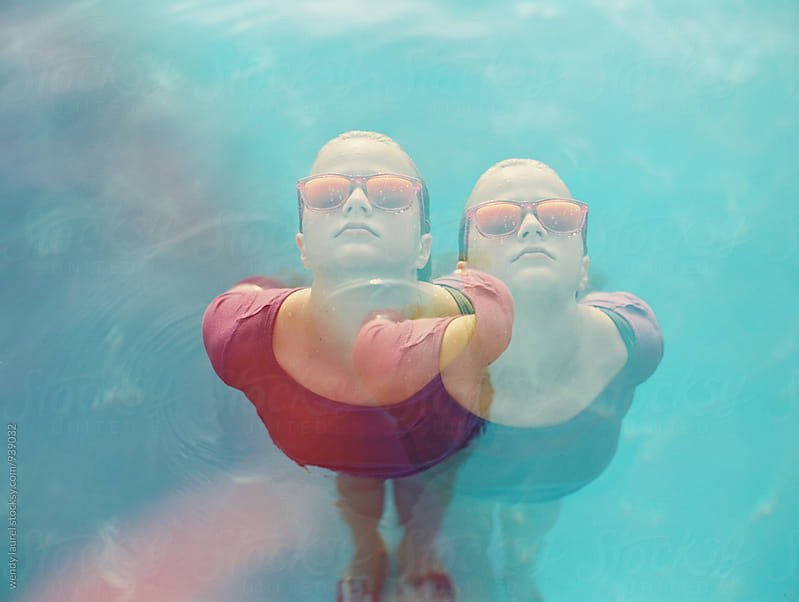 colorful pool fun with girl with multiple exposures by wendy laurel for Stocksy United