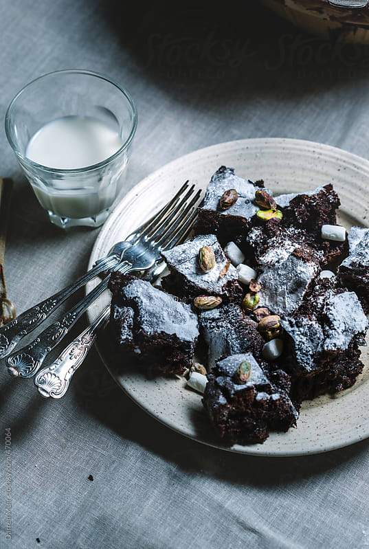 Chocolate and pistachio brownies.  by Darren Muir for Stocksy United