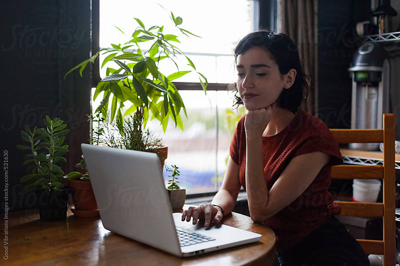 Brunette working with a Laptop from Home by Good Vibrations Images for Stocksy United