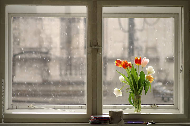 Window with snowfall outside by Per Swantesson for Stocksy United