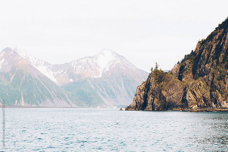 A Sheer Island Cliff Jutts Into The Ocean Waters Of Resurrection Bay Alaska by Luke Mattson for Stocksy United