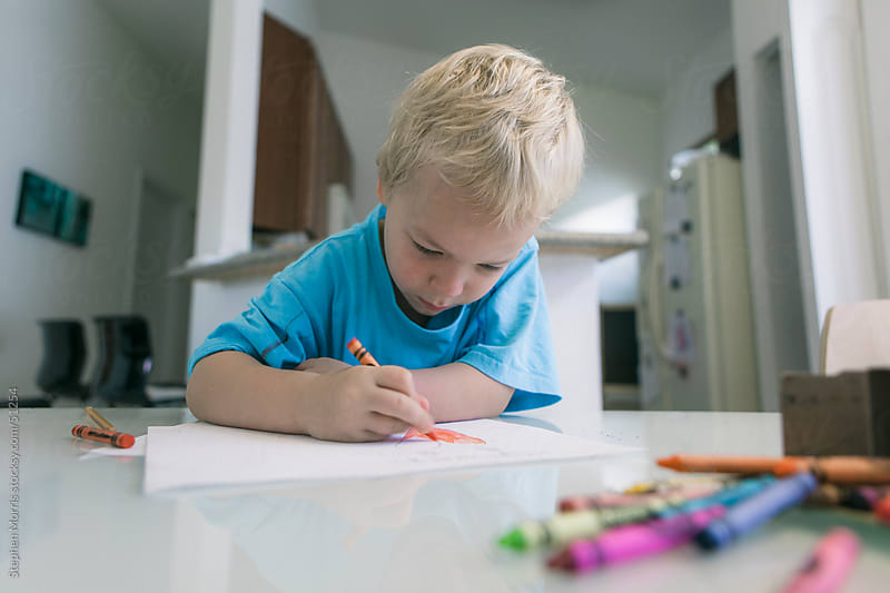 Boy Drawing with Crayons by Stephen Morris for Stocksy United