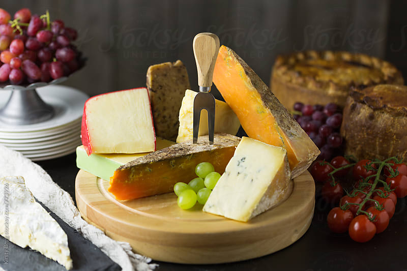 Horizontal shot of cheese board with cheese fork by Kirsty Begg for Stocksy United