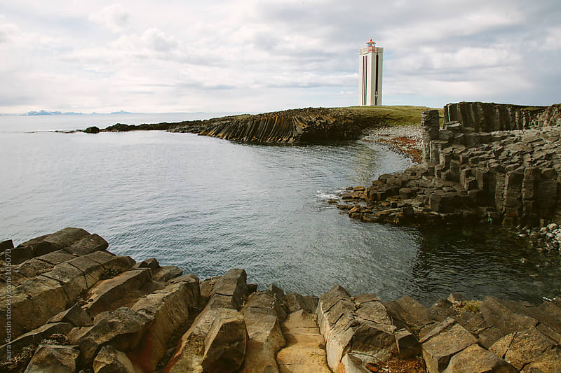 Lighthouse Along A Rocky Iceland Coast by Laura Austin for Stocksy United