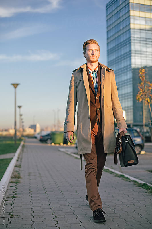 Ginger Businessman on the Street by Lumina for Stocksy United