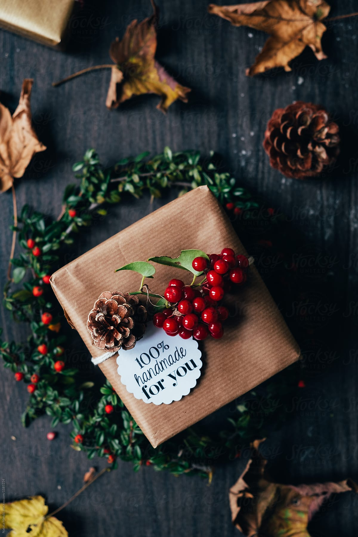 Christmas Gifts On Wooden Background | Stocksy United