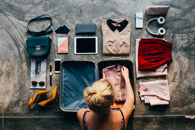 Woman Packs Her Suitcase