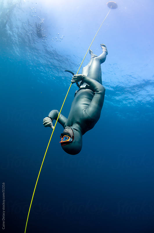 Free diving in crystal clear water by Caine Delacy for Stocksy United