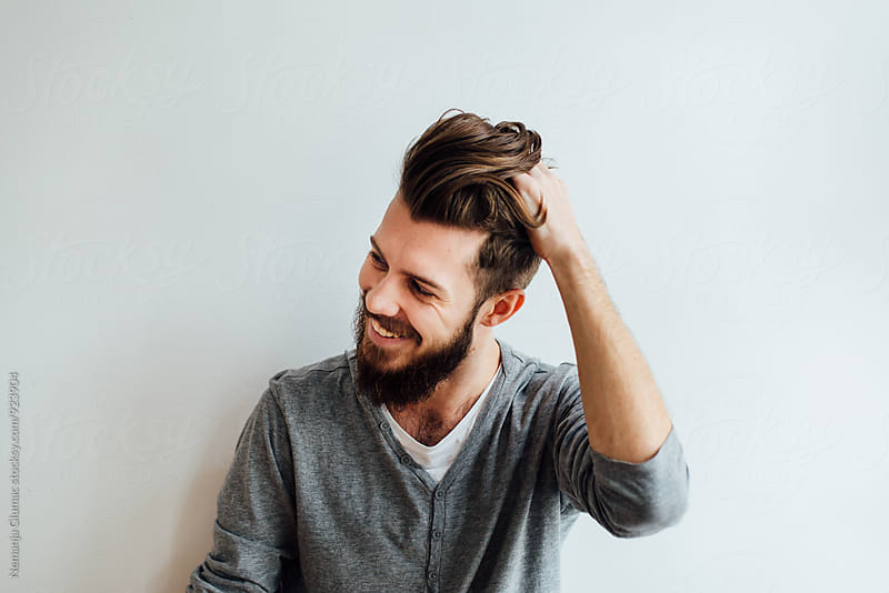 Handsome Bearded Man Playing With His Hair  by Nemanja Glumac for Stocksy United
