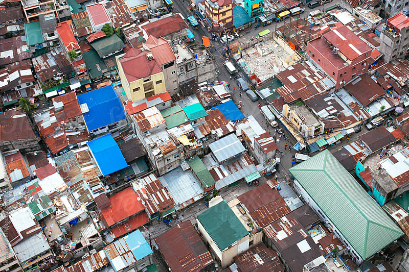 Aerial view of residential portion of a city  by Lawrence del Mundo for Stocksy United