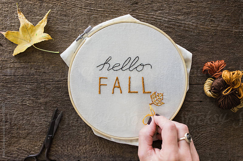 Hello Fall greeting stiched into canvas by Amy Covington for Stocksy United