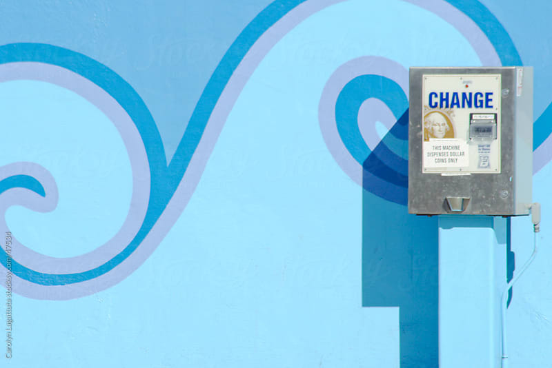 Change machine against a pretty blue mural by Carolyn Lagattuta for Stocksy United