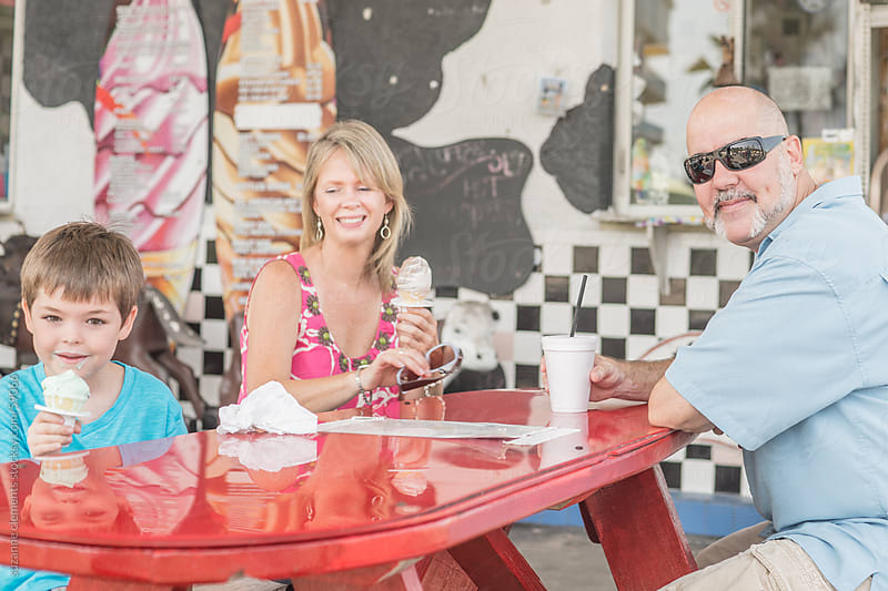 Family Enjoys Ice Cream Together on a Hot Summer Day by suzanne clements for Stocksy United