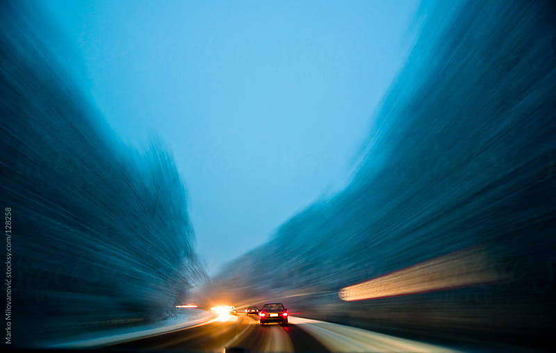 Car on the road, going fast by Marko Milovanović for Stocksy United