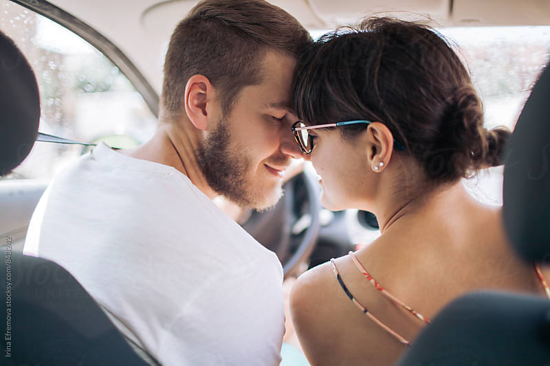 Young affectionate couple in a car by Irina Efremova for Stocksy United