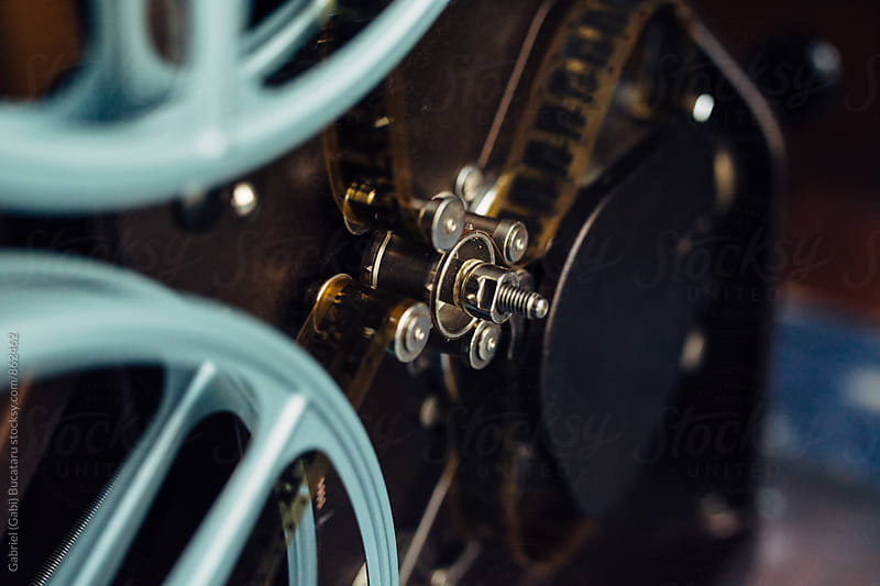 Traction wheel on an old 16mm movie projector by Gabriel (Gabi) Bucataru for Stocksy United