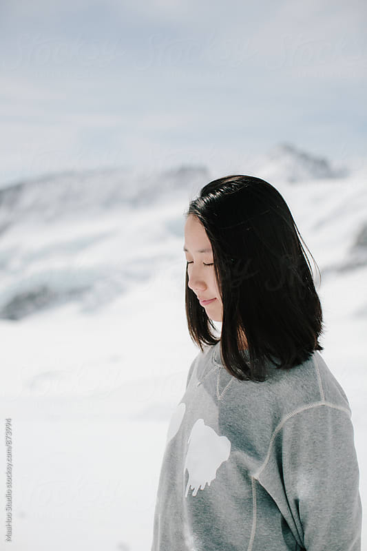 Profile of a young woman,Swiss Alps, Switzerland by Maa Hoo for Stocksy United