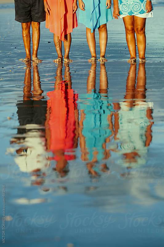 People Standing in the SEA Shore Reflected on Water by VICTOR TORRES for Stocksy United