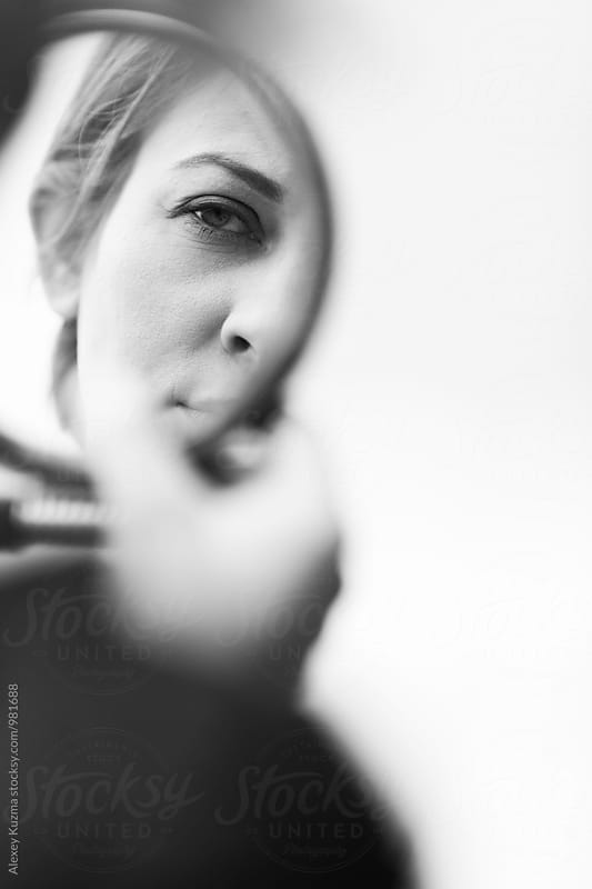 androgynous woman with round mirror. by Vesna for Stocksy United