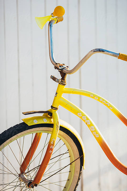 Colorful retro bike parked on the street by Maja Topcagic for Stocksy United