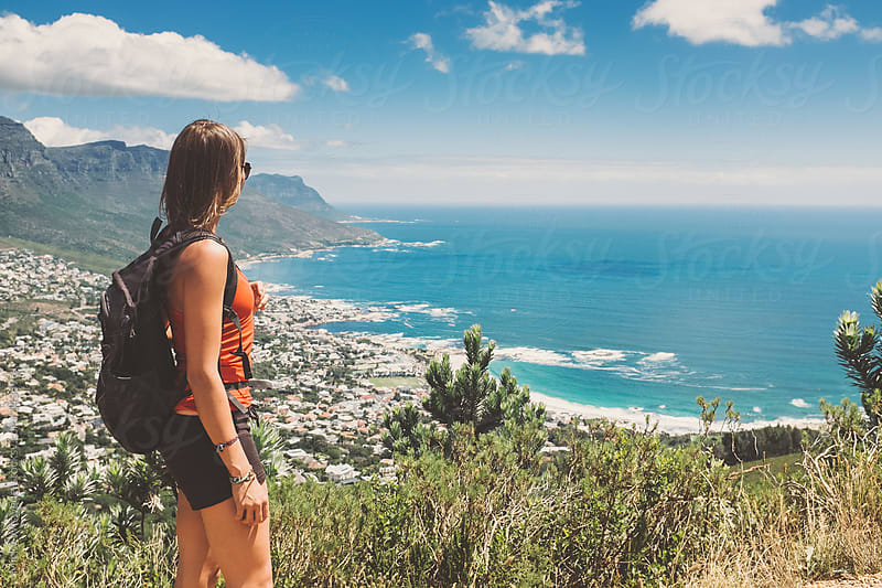 Young active woman enjoying the view on a mountain hike by Micky Wiswedel for Stocksy United