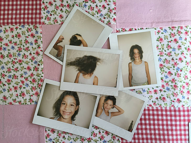polaroid of little girl on a Patchwork fabric by Guille Faingold for Stocksy United