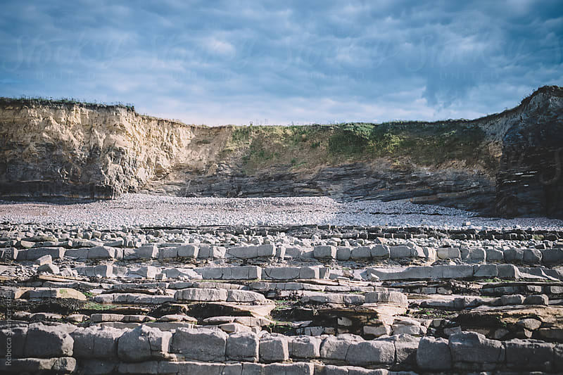 Cliffs full of fossils on Kilve beach in Somerset, England by Rebecca Spencer for Stocksy United