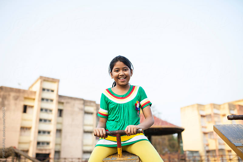 Indian girl playing and funmaking by PARTHA PAL for Stocksy United